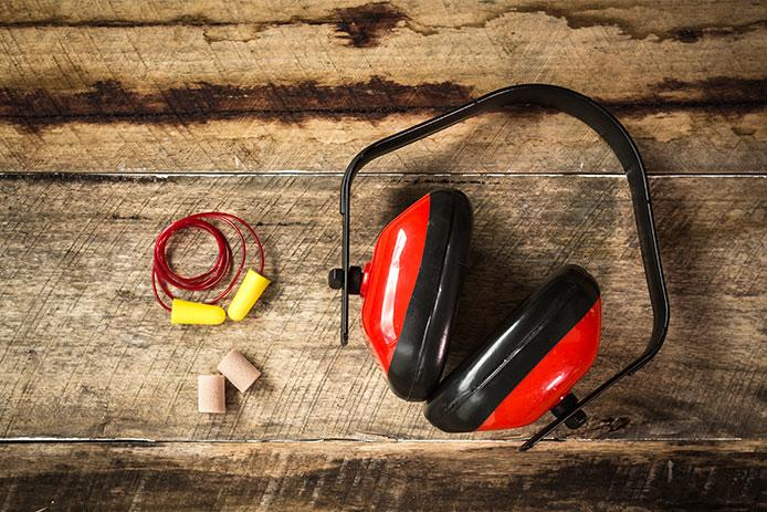 Ear safety protection on wood background
